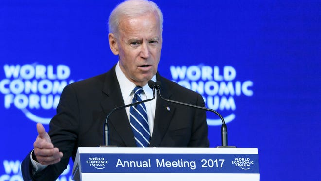 Vice PresidentJoe Biden addresses the assembly on the second day of the World Economic Forum, on Wednesday  in Davos, Switzerland.         With the world's elite holding its breath until Donald Trump becomes the next US president, outgoing Vice-President Joe Biden addresses the World Economic Forum in Davos / AFP PHOTO / FABRICE COFFRINIFABRICE COFFRINI/AFP/Getty Images ORIG FILE ID: AFP_K37N1