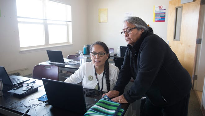 Student Joann Plummer works with Navajo Court Transcription and Interpretation Program instructor Esther Yazzie-Lewis Wednesday at Navajo Technical University in Crownpoint.
