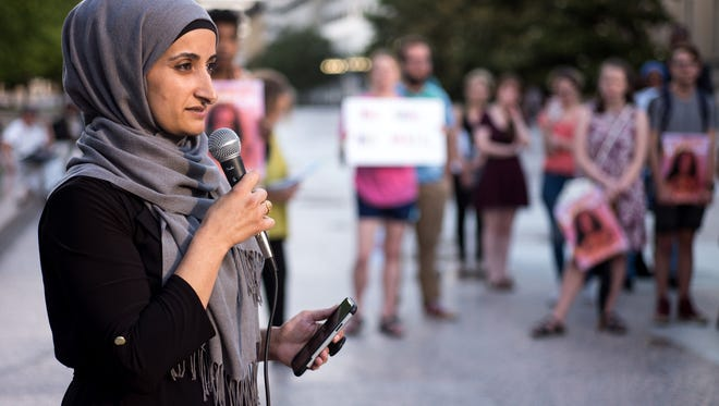 Kasar Abdulla, who is originally from Iraq, during a rally organized by the American Muslim Advisory Council at Legislative Plaza, Tuesday, June 26, 2018, in Nashville, Tenn. The rally was in response to the Supreme Court's Tuesday decision on President Trump's travel ban.