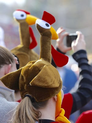 A spectator dresses appropriately at the Webster Turkey Trot on Nov. 26, 2015.