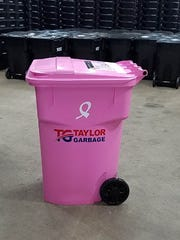 Taylor Garbage placed pink garbage cans throughout