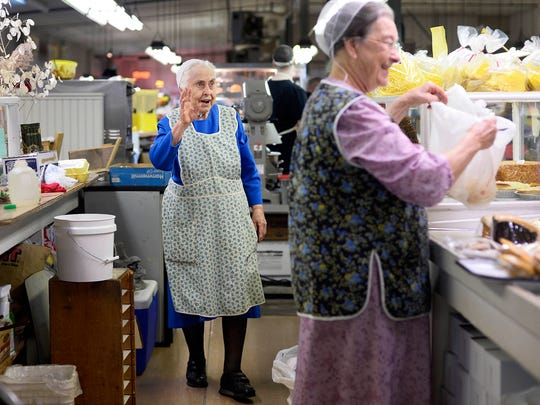 Dorothy Marks, center, waves to a customer being helped by her sister-in-law, Norma Jean Keeney, at Eastern Market in Springettsbury Township. Marks opened the stand 60 years ago. Her last day open will be December 31st. Keeney has been helping Marks at the stand for the last 15 years.