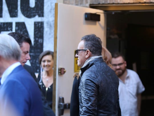 Bruce Springsteen enters the Walter Kerr Theater in New York Thursday prior to his opening night  performance.