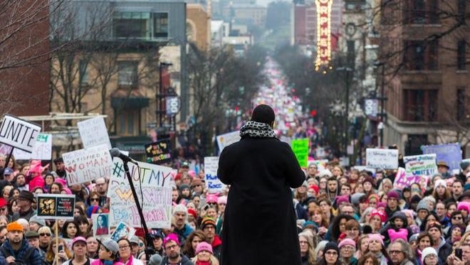 Sagashus Levingston addresses the crowds at the Women's March on Madison at the Capitol.