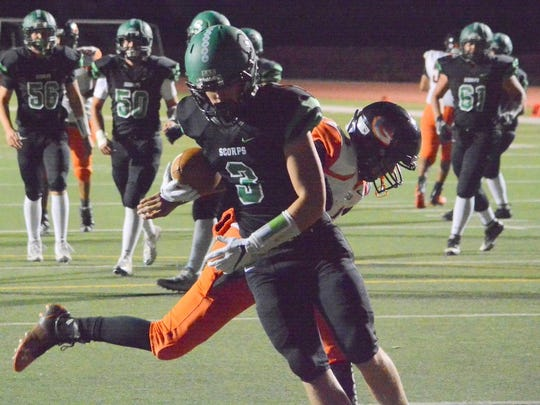 Farmington's Ethan Todd crosses the goal line for a 3-yard touchdown reception during the first half against Gallup in Friday's District 1-5A opener at Hutchison Stadium.