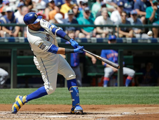 Seattle Mariners' Nelson Cruz hits a three-run home run in the first inning of a baseball game against the New York Mets, Sunday, July 30, 2017, in Seattle. (AP Photo/Ted S. Warren)