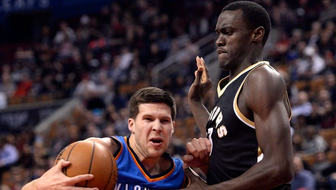 Oklahoma City Thunder forward Doug McDermott (25) drives to the net past Toronto Raptors forward Pascal Siakam (43) during the second half of an NBA basketball game Thursday, March 16, 2017, in Toronto.