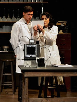 "Matthew Frietze, left, as Ray Gosling and Nora Thomas Medina as Dr. Rosalind Franklin, examine ""Photograph 51,"" on stage through Feb. 11 at the Black Box Theatre."