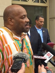Dwight Patton, president of Cincinnati Black United Front, speaks at a news conference Friday at prosecutor's office.