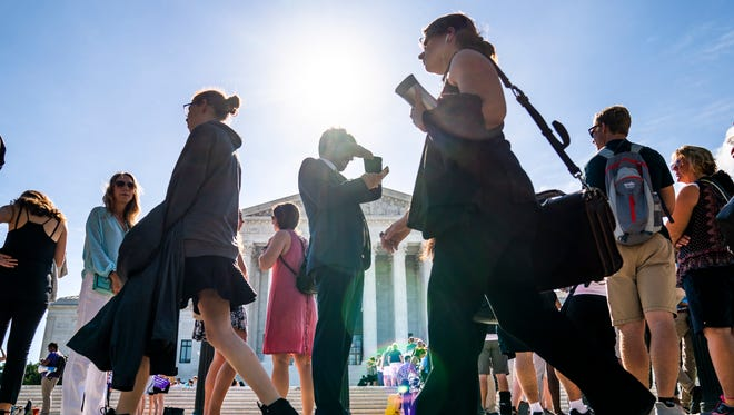 The street and plaza outside the Supreme Court was swarming with people Monday as the court neared the end of its 2017 term.
