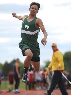 Aaron Nieves of Passaic Valley triple jumping at county championships.