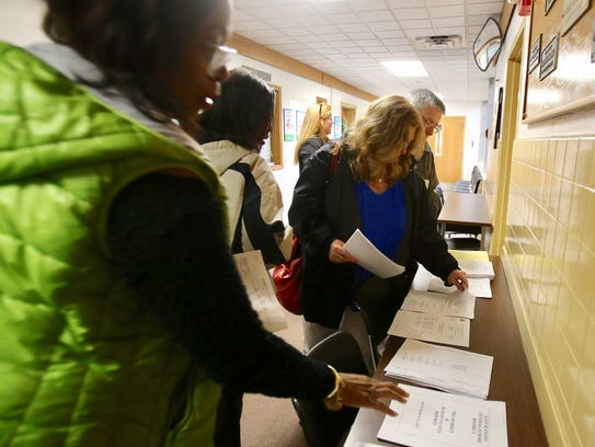 Residents pick up the agenda for the East Ramapo budget