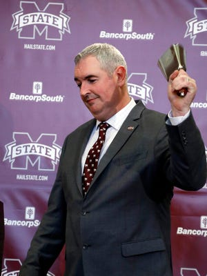 New Mississippi State football coach Joe Moorhead rings the the traditional cowbell prior to addressing reporters and team supporters at his official introduction.