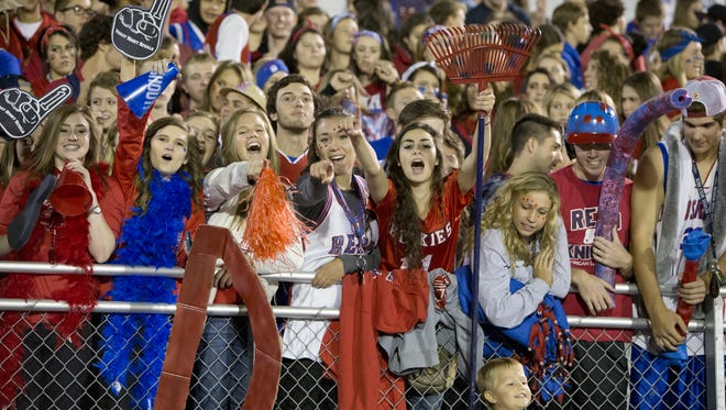 Reno High fans cheer for the Huskies during a game on Oct. 3.