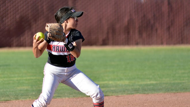 Centennial second baseman Juliana Vidal turns the frontend of a double play as the Hawks took on the Las Cruces Bulldawgs on Friday night at Field of Dreams.