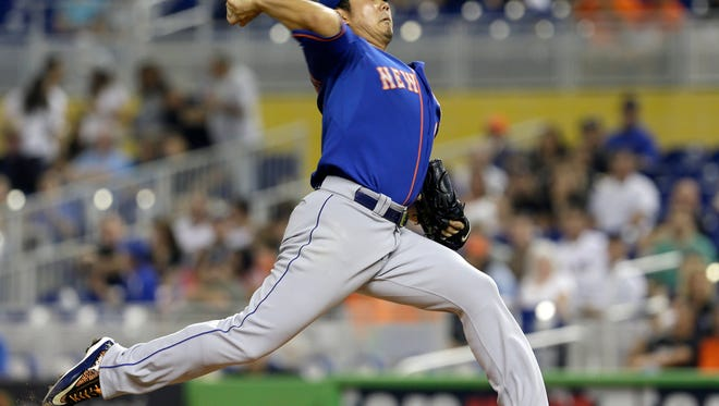 New York Mets' Daisuke Matsuzaka pitches against the Miami Marlins in the first inning of a baseball game in Miami, Friday, June 20, 2014.