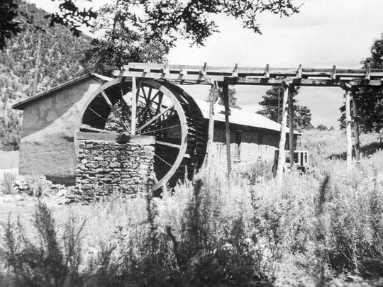 The Old Mill when it sat alone on a dusty road.