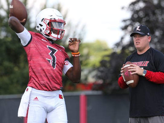 Redshirt freshman Malik Cunningham, shown with quarterbacks