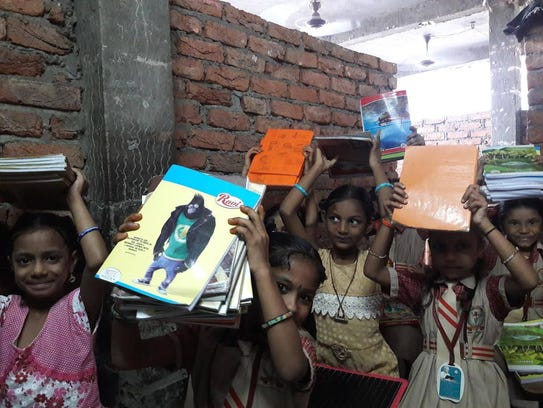 Santhi orphans with their new books