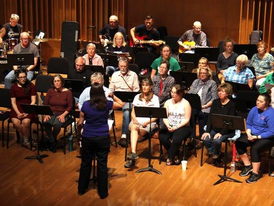 The Intergenerational Rock Band rehearses at Clara
