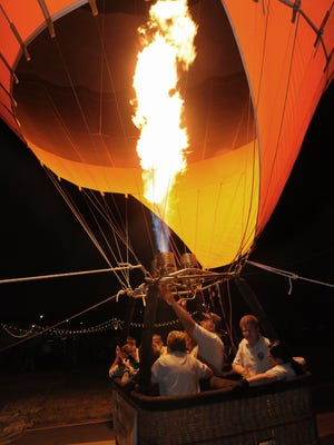 A hot air balloon moments before lifting off for a tethered ride at last year's Starlight Glow. This year's is set for August 25.