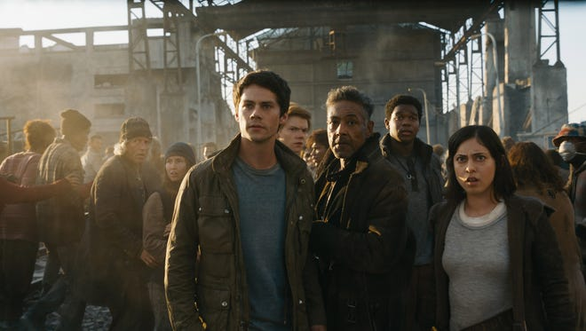 Dylan O'Brien (left, as Thomas) leads the way in 'Maze Runner: The Death Cure' with Newt (Thomas Brodie-Sangster),  Jorge (Giancarlo Esposito), Frypan (Dexter Darden) and Brenda (Rosa Salazar).