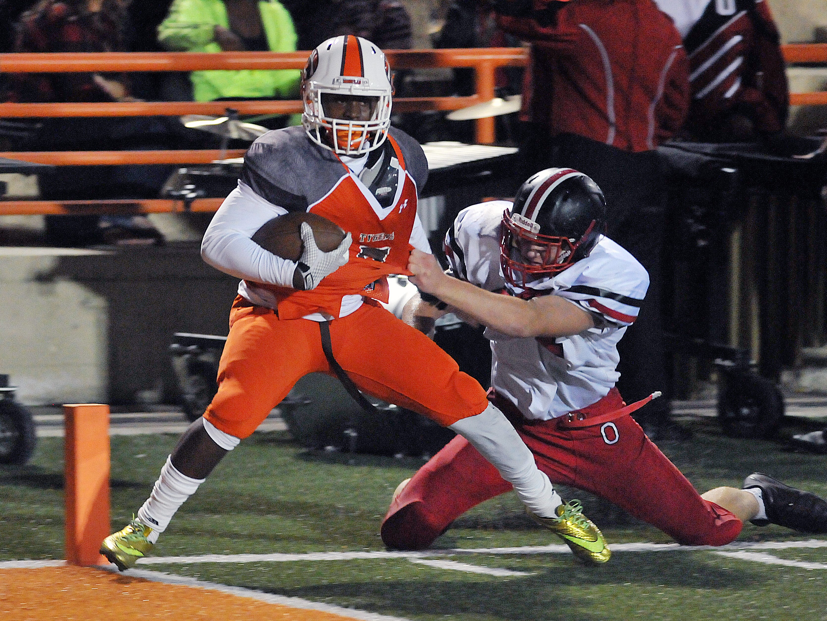 Mansfield Senior's Sa'Qunn Johnson gets into the end zone during their game Friday night against Orrville.