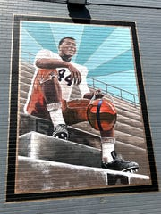 Ernie Davis Academy art students painted a mural of the school's namesake on the side of New York Sport and Fitness in downtown Elmira.