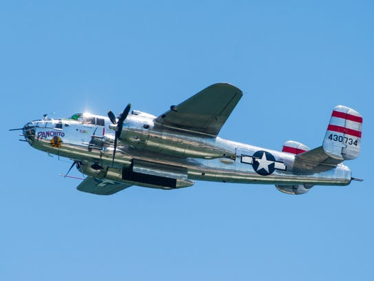 "The B-25 Mitchell ""Panchito"" flies over 16th Street in Ocean City during the Ocean City Air Show."