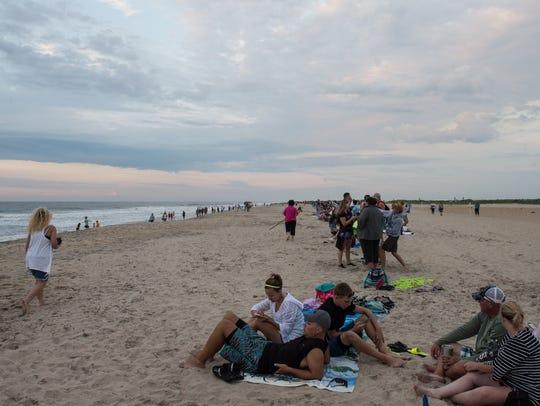 A crowd awaits the start of the Beach Walk at Chincoteague