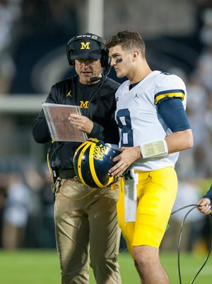 Michigan head coach Jim Harbaugh talks to quarterback John O'Korn in the second quarter of the Wolverines' 42-13 loss to the Nittany Lions Saturday, which dropped UM to 5-2 overall, 2-2 in the Big Ten.