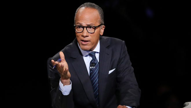 Moderator Lester Holt, anchor of NBC Nightly News, asks a question of Democratic presidential nominee Hillary Clinton during the presidential debate with Republican presidential nominee Donald Trump on Sept. 26, 2016 at Hofstra University in Hempstead, N.Y.