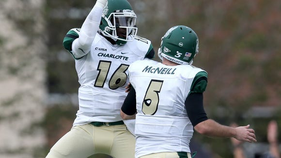 Charlotte quarterback Hasaan Kluge (16) celebrates his touchdown pass with Lee McNeill (5) in the first half against the Southern Miss Golden Eagles at M.M. Roberts Stadium. Mandatory Credit: Chuck Cook-USA TODAY Sports