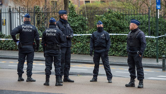 Police on guard duty in the area  in front of Central Station after it was sealed off following discovery of suspect packages, in Brussels, Belgium on Sunday, Nov. 22, 2015.