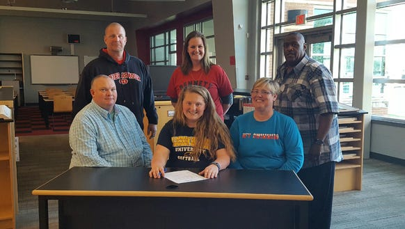 McKayla Williams (center) signs her letter of intent