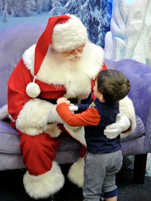Santa visits with a child at a previous event for special needs children. The event for children has come to Laurel Park Place in Livonia and will take place Sunday morning.