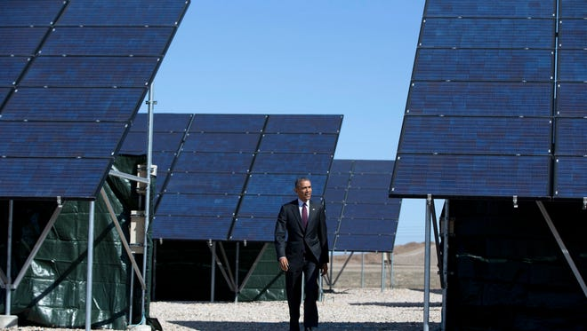 President Barack Obama walks through a solar farm at Hill Air Force Base in Utah on April 3, 2015. (AP Photo/Carolyn Kaster)