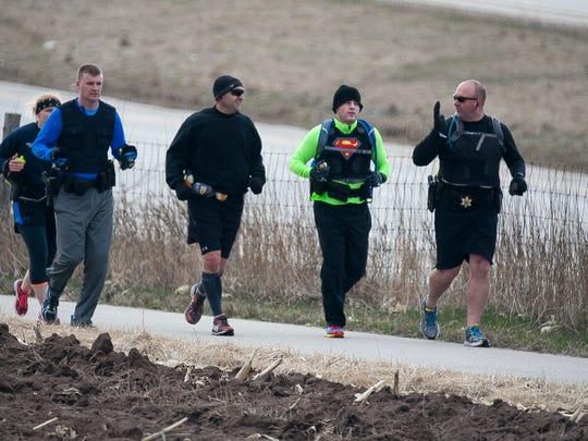 Police officers train on Old Plank Road Trail near Sheboygan Falls Friday April 10.