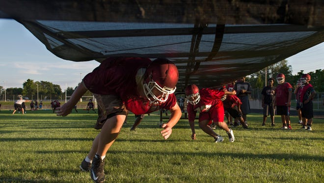 The Peoria High football team runs through drills in this 2016 file photo. The Illinois High School Association is awaiting approval from the Illinois Department of Public Health to release 'Return to Play Guidelines' for statewide athletics.