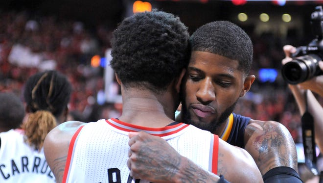Indiana Pacers forward Paul George (right) embraces Toronto Raptors guard DeMar DeRozan  after the Raptors' 89-84 win in Game 7 of the first round of the NBA playoffs May 1, 2016,   at Air Canada Centre.