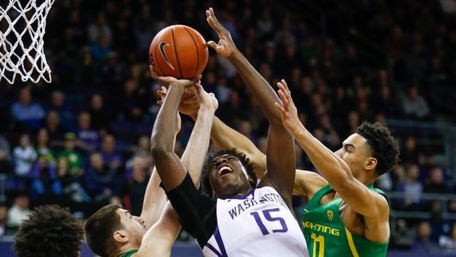 Jan 4, 2017; Seattle, WA, USA; Washington Huskies forward Noah Dickerson (15) puts ups shot against Oregon Ducks forward Roman Sorkin (41) and forward Keith Smith (11) during the first half at Alaska Airlines Arena at Hec Edmundson Pavilion. Mandatory Credit: Joe Nicholson-USA TODAY Sports
