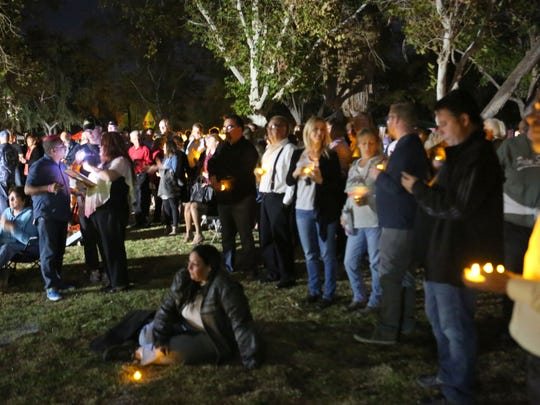People attend the Transgender Day of Remembrance at Ruth Hardy Park in Palm Springs, Friday, November 20, 2015.