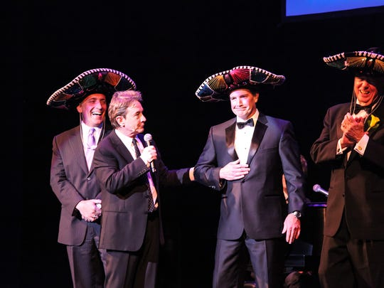 """State Theatre Benefit Gala performer Martin Short on the State Theatre stage with his """"Three Amigos."""" From left to right: Michael Antoniades, President and CEO at Robert Wood Johnson University Hospital; Martin Short; Gala patron Michael Harvey; and State Theatre Patron Honoree Robert Campbell."""