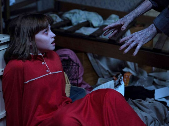 "Janet (Madison Wolfe) is terrorized in ""The Conjuring"