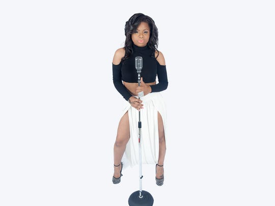 Alaina Renae sings soul and R&B style music. She can take it to the house.