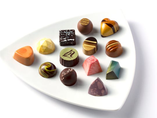 Chocolatiers Molly Cook and Chris Botterman will compete Aug. 20-22 at the 2016 Chocolatier of the Year competition. They will create chocolates similar to these from Norman Love Confectioners, where both are employed.