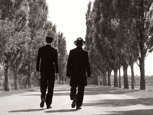 The arrival of two Jewish Orthodox men in a small Hungarian