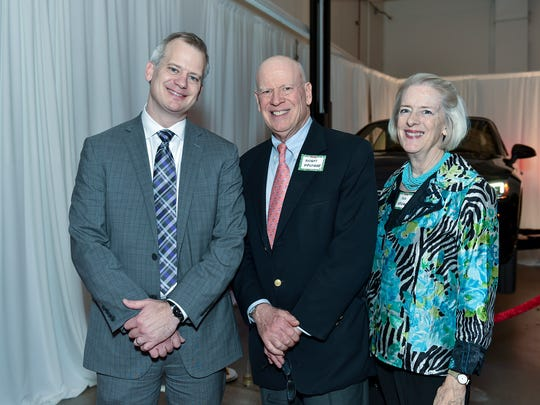 Audi General Manager Devin Carlson, left, with Honorary Chairs Ann and Knight Kiplinger.