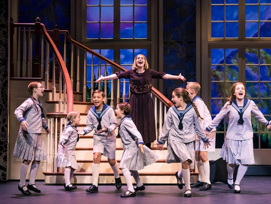 Jill-Christine Wiley as Maria and the von Trapp children.