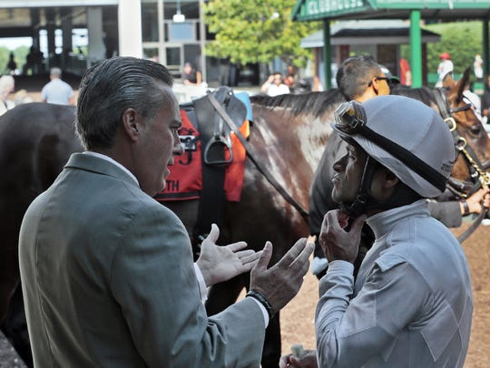 Trainer Anthony Margotta talks with jockey Jose Ferrer